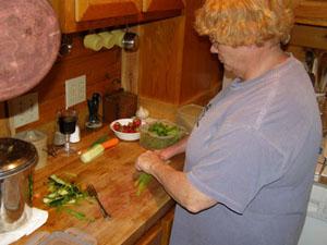 Alice preparing local food